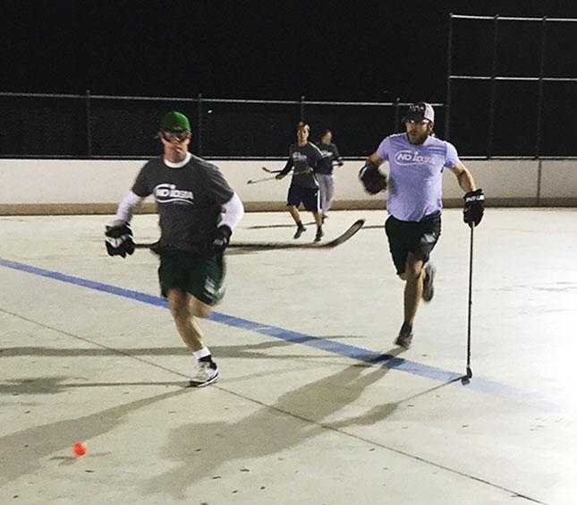 No Idea Sports - Adults Playing Floor Hockey